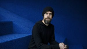 Twitter founder Jack Dorsey, looking thin and pale, wearing stark black clothing and a full beard